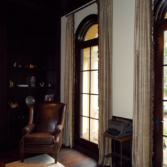 Stationary panels over arched windows.