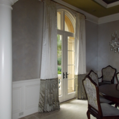 Stationary panels over arched doors.